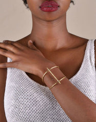 Cross Cuff in Hammered Brass