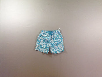 Short surf turquoise fleurs blanches