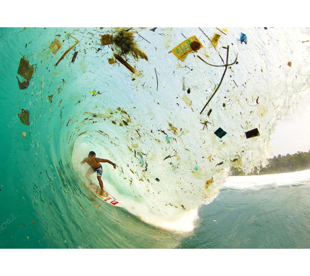 Wave Of Change Image Of A Surfer In A Wave Full Of Trash In Indonesia