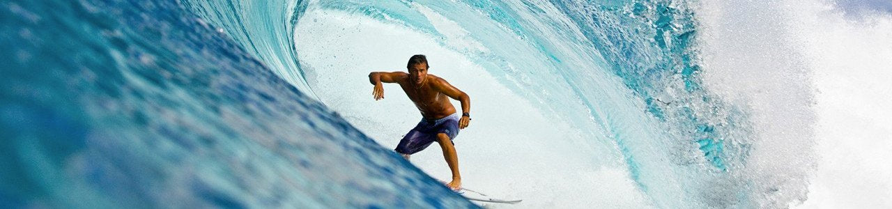 Image of a surfer Stephen Koehne catching a big wave