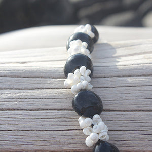 Black Kukui Nut Lei with white Shells