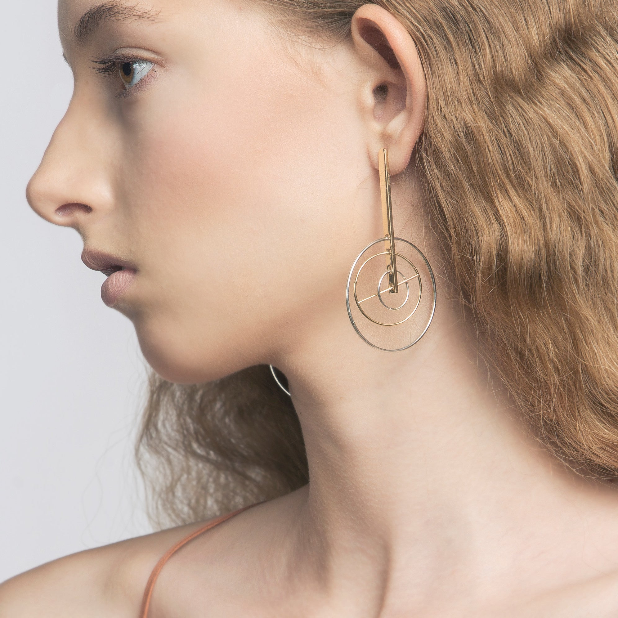 Kinetic Earring detail on model