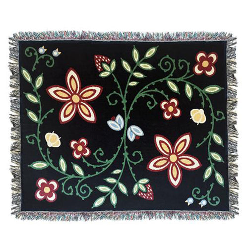 Product photo oof Woodlands throw blanket in black, design shows- strawberries, wild rice, blueberries, and a green vine connecting all the plants