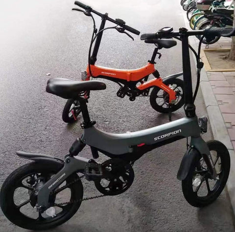 Minimotors Food riders' foldable ebikes w rear suspension and  w LTA orange seal Certification