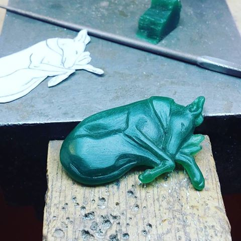 wax carving of sleeping greyhound / whippet