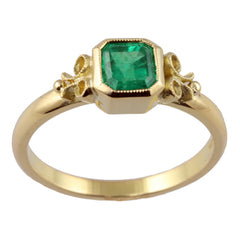 yellow gold and emerald engagement ring