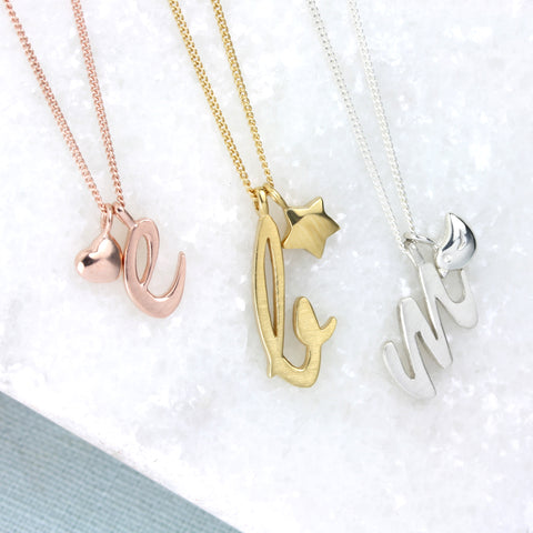 Letter pendants with heart, bird and star charm