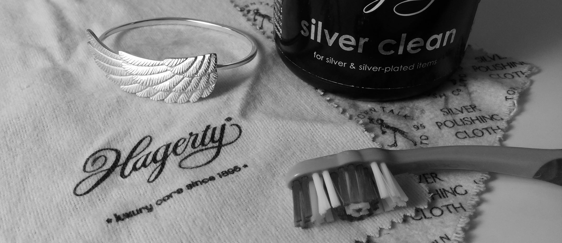 silver bangle and cleaning products