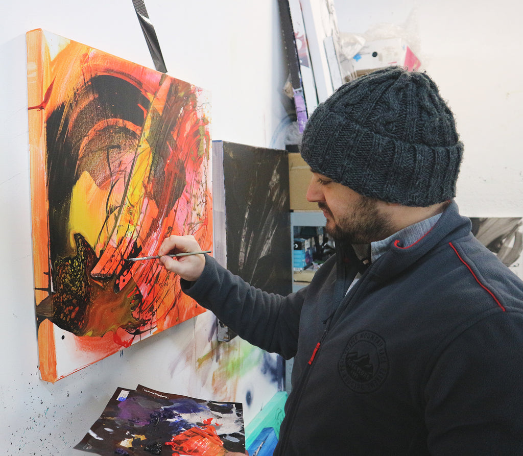 sports artist david roman in studio painting ufc fighter champion amanda nunes