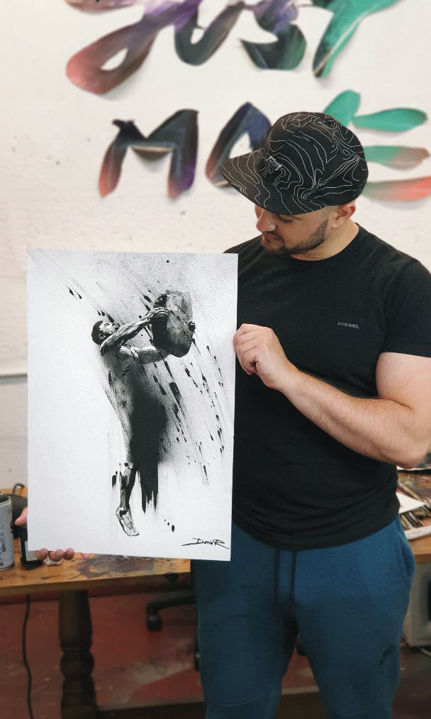 david roman art holding painting of dj murakami. The painting is created with watercolours and captures the movement and energy of the outdoor training