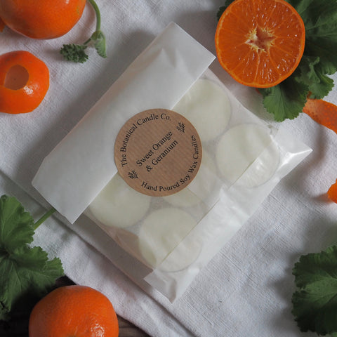 THE BOTANICAL CANDLE CO. PACK OF SIX TEA LIGHT CANDLES - SWEET ORANGE AND GERANIUM