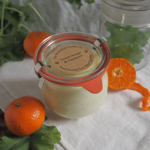 THE BOTANICAL CANDLE CO. 370ML LARGE WECK GLASS JAR CANDLE - SWEET ORANGE AND GERANIUM