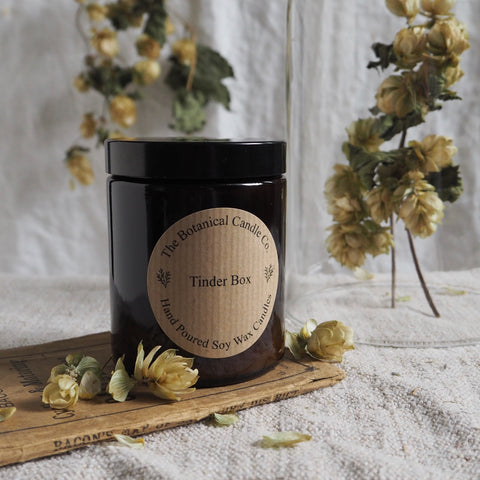 THE BOTANICAL CANDLE CO. 180ML MEDIUM AMBER GLASS JAR CANDLE - TINDER BOX