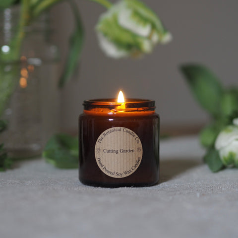 THE BOTANICAL CANDLE CO. 120ML SMALL AMBER GLASS JAR CANDLE - CUTTING GARDEN