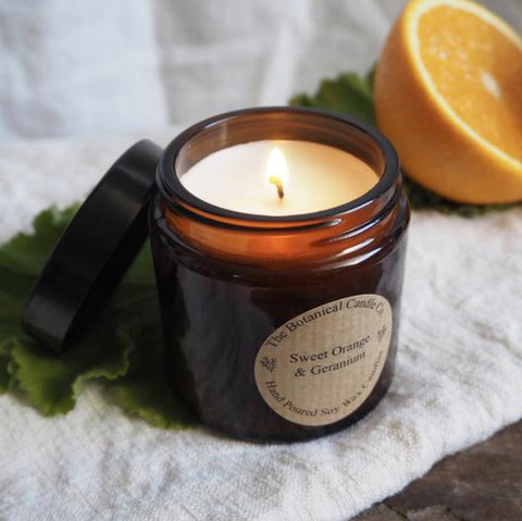 THE BOTANICAL CANDLE CO. 120ML SMALL AMBER GLASS JAR CANDLE - SWEET ORANGE AND GERANIUM