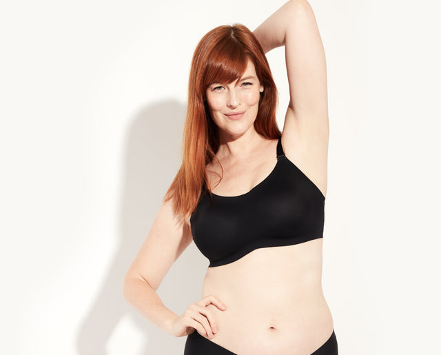 Katy is a 36DD, she's wearing a size 7 bra. Her bottoms are the Athletic Boyshort. color:Black/Beige