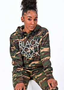 Our 9 oz Green Camo logo Black Don't Crack hoodie is a classic fit sweatshirt. It has a roomy front kanga pocket, an adjustable drawstring hood to keep you warm and cozy. This signature overhead hoodie is made with soft but durable dual blend fabric. If you want comfort and style make this your favorite all day hoodie.