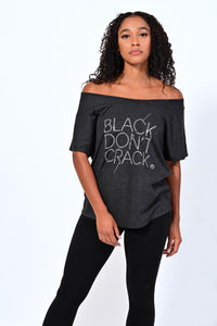 Vintage Black is the new black! This cute dolman is very versatile and can be styled on or off the shoulders. The tri-blend fabric is lightweight and is a great top to wear through all seasons. Ladies make this your go to top!   50% Polyester 25% Combed Ring-Spun Cotton 25% Rayon  Machine Wash Gentle Hang Dry