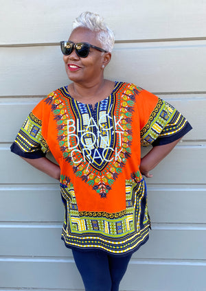 Our Black Don't Crack logo dashiki certainly makes a bold statement. It's 100% cotton with stay fast dye so the print won't fade or shrink. This multi-colored Afrocentric dashiki is lightweight and can be worn through the seasons.   100% Cotton          Machine Wash            Hang Dry