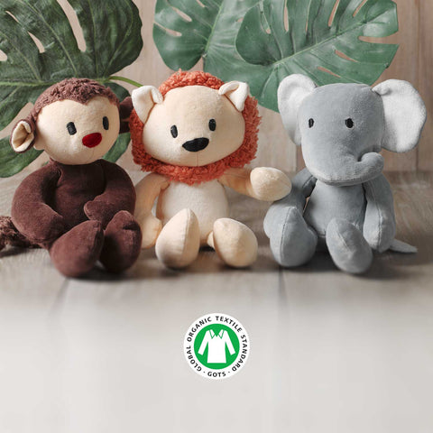 three Bears for Humanity stuffed animals sit together on a shelf