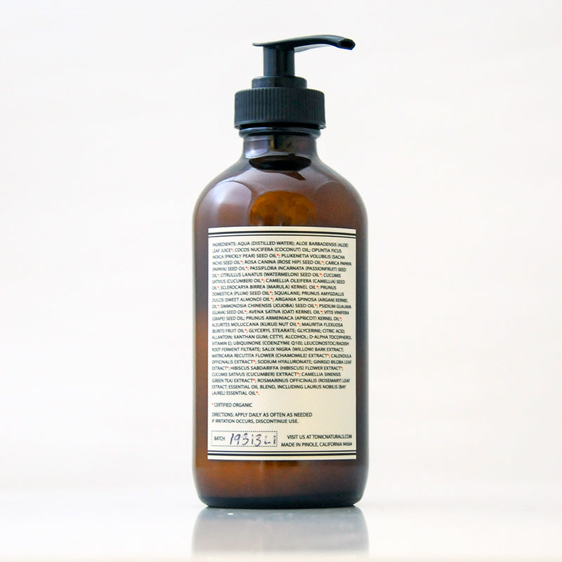 Bay Laurel Body Lotion with Chamomile and Hibiscus Extracts by TONIC in an amber glass bottle with a black pump on an off white background