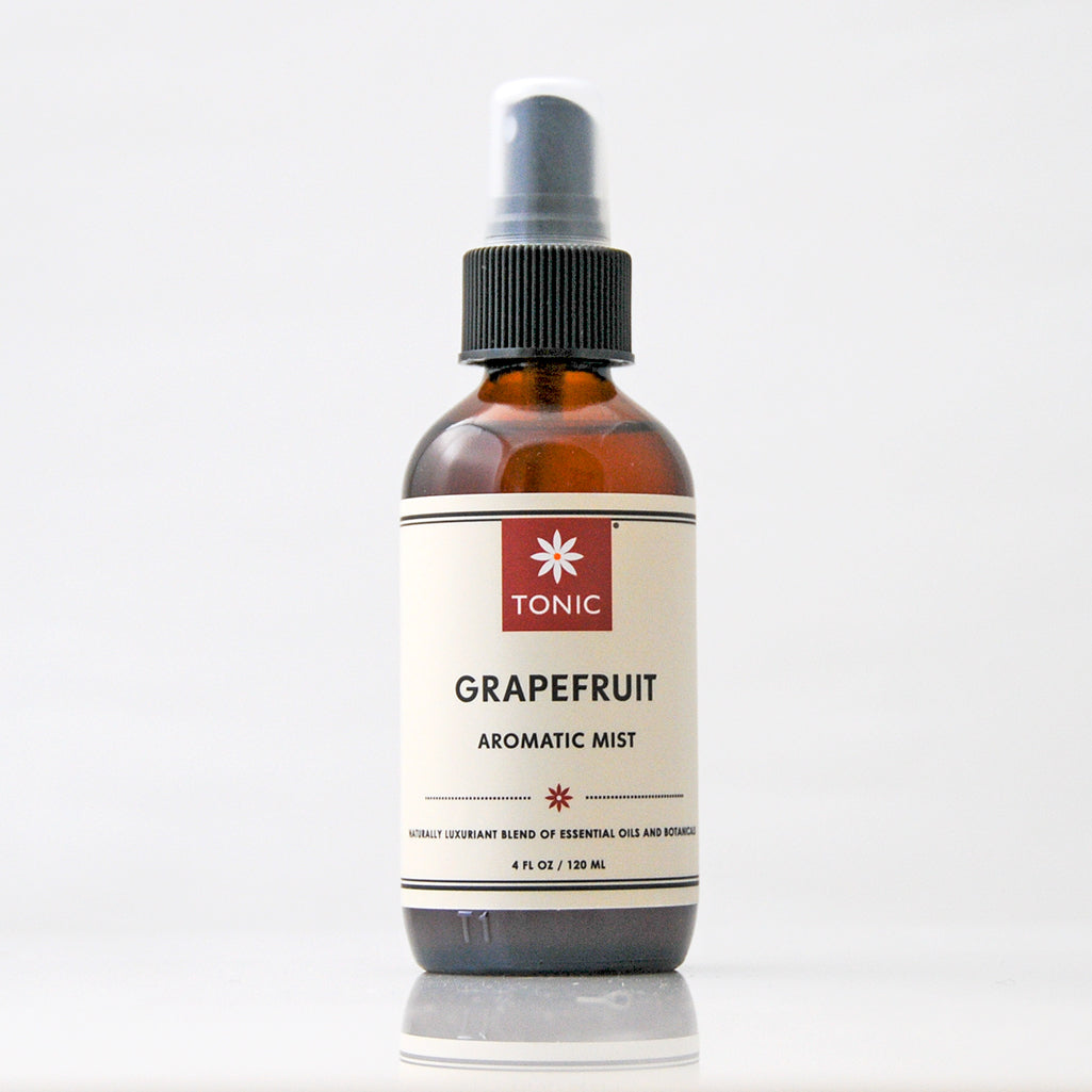 Grapefruit Essential Oil Aromatic Room Mist in amber glass bottle with black pump