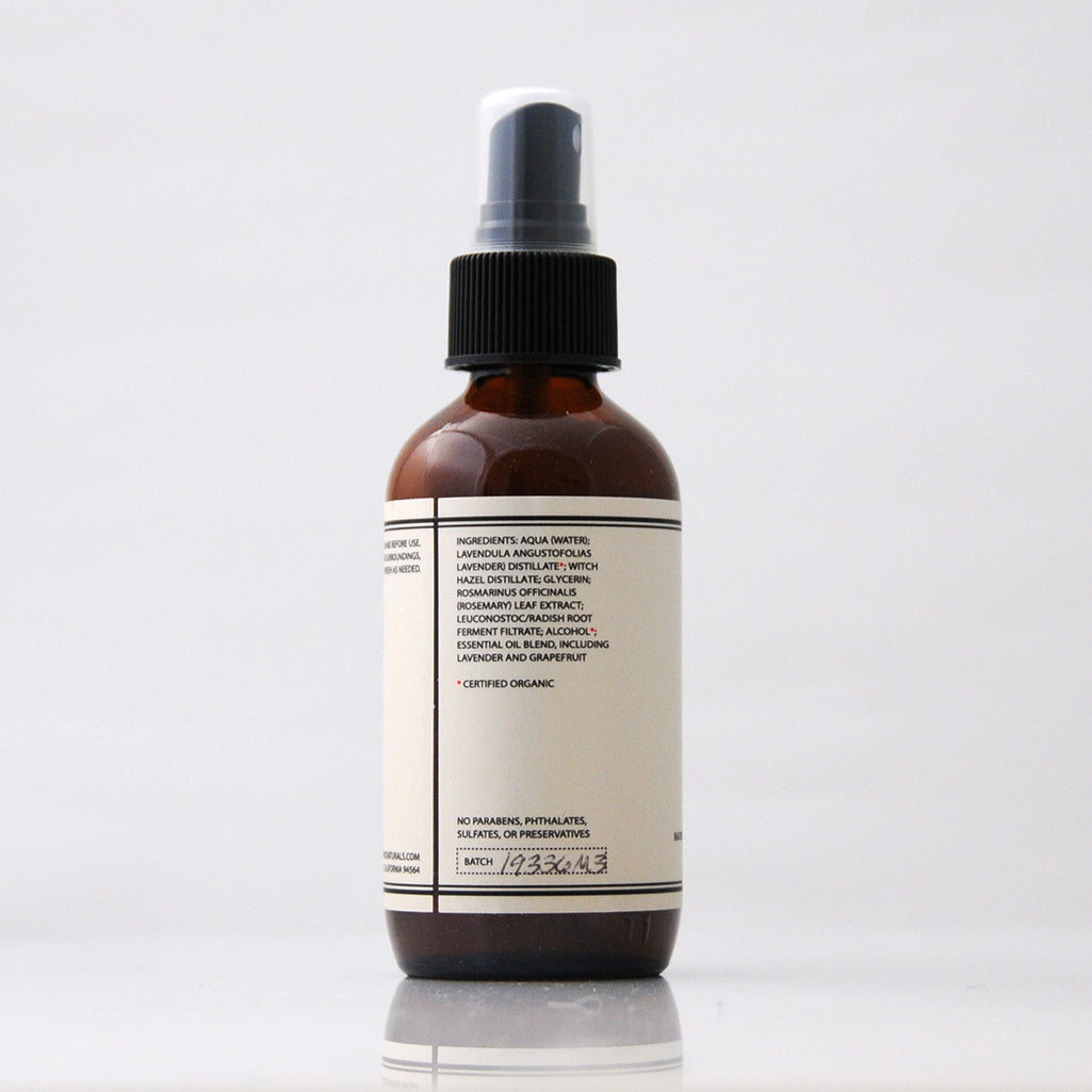 TONIC Lavender Aromatic Mist Room Spray in an amber glass bottle against a light grey background