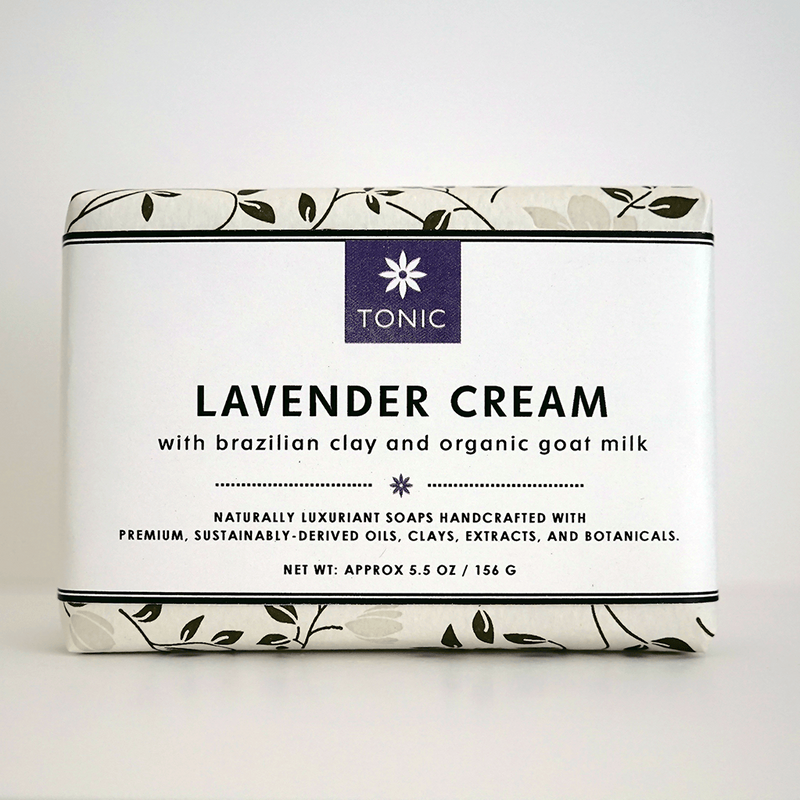 Unwrapped Lavender Cream Bar Soap on dark slate | TONIC