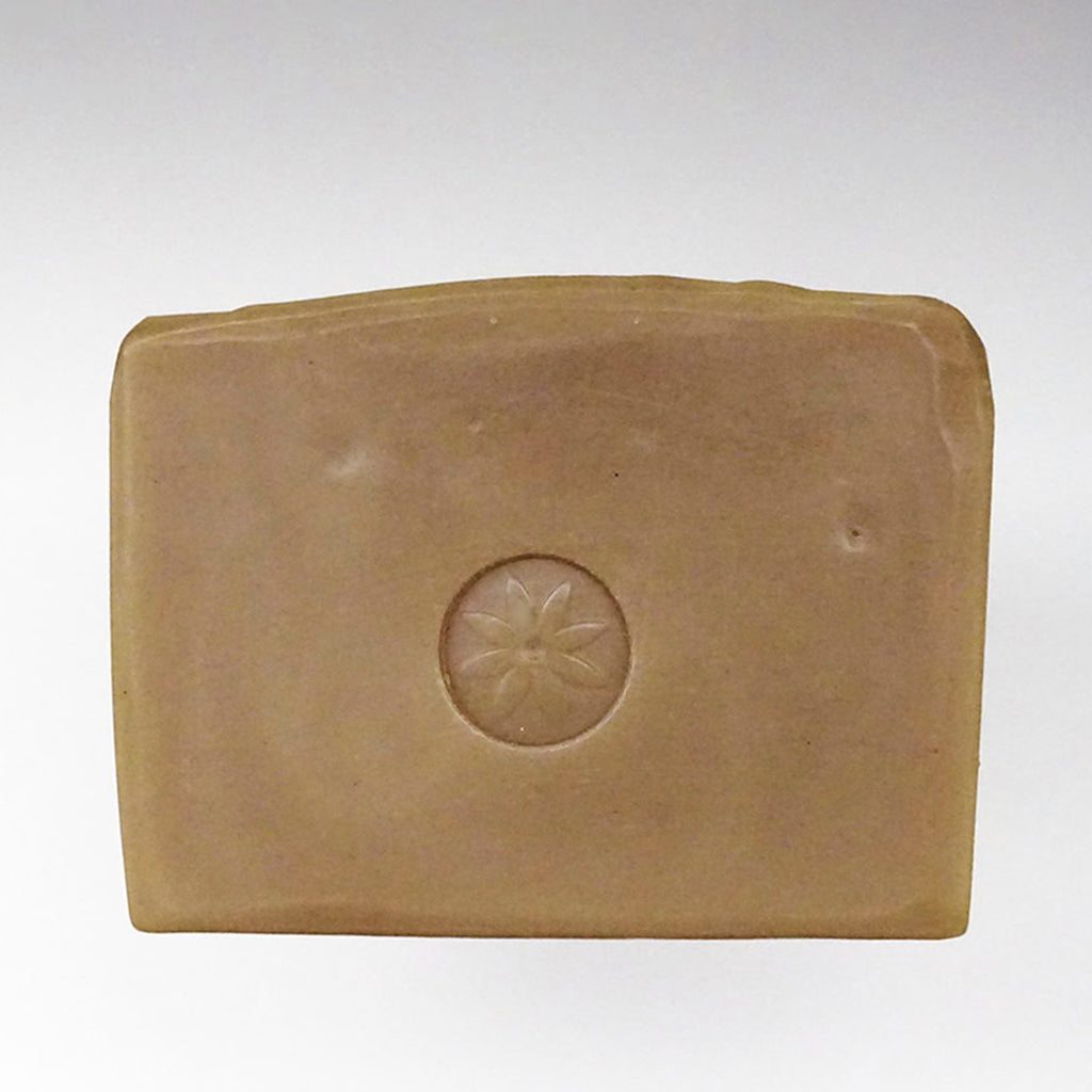 Tonic Naturals Pine Bar Soap unwrapped on a white background