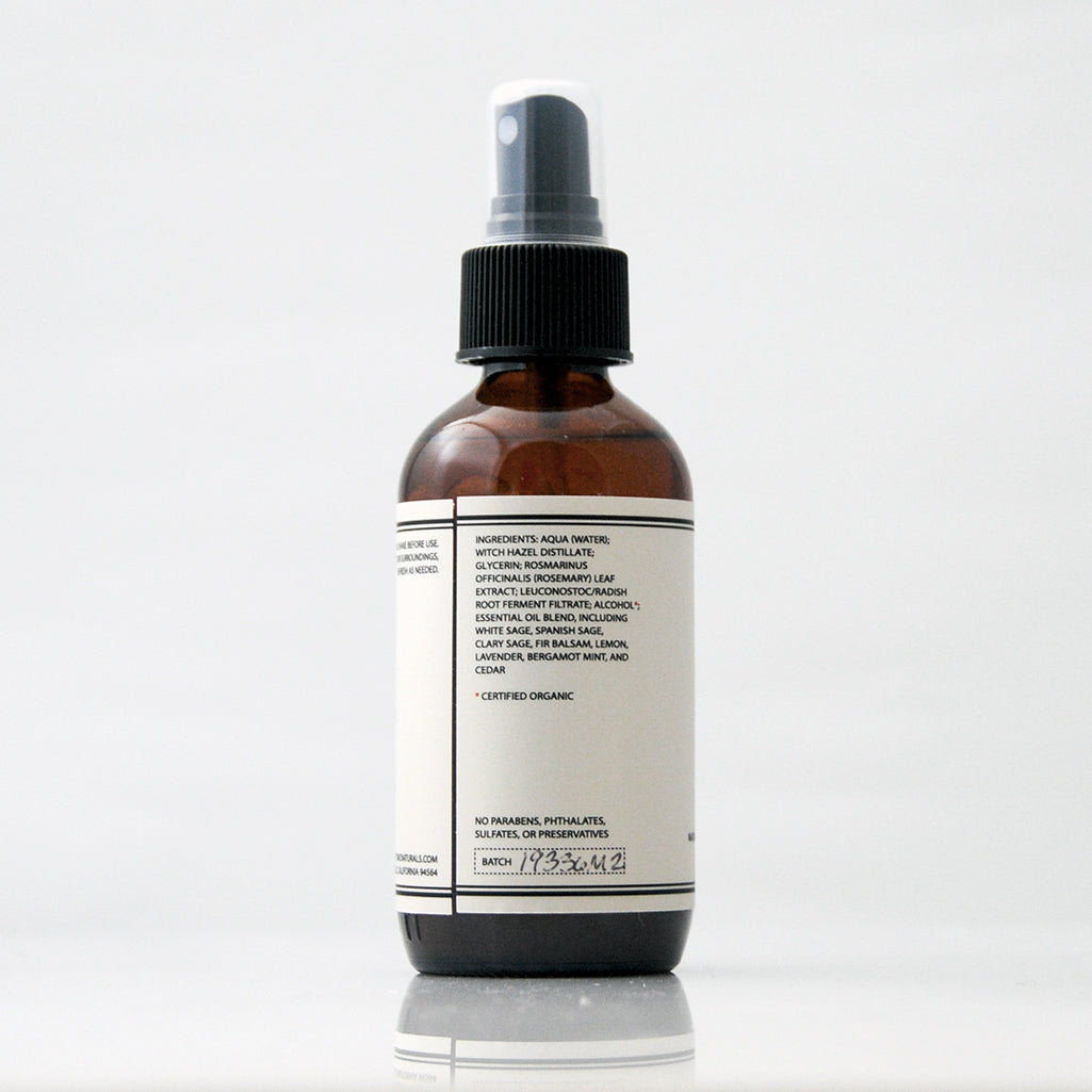 Sage Aromatic Room Spray in a glass amber bottle with a black pump on an off white background