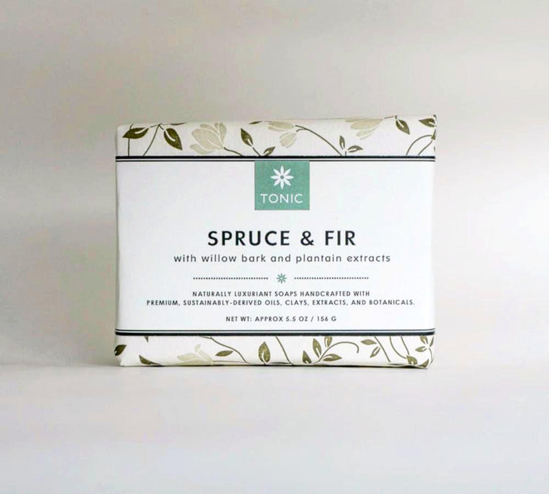 Unwrapped spruce and fir soap bar on slate background