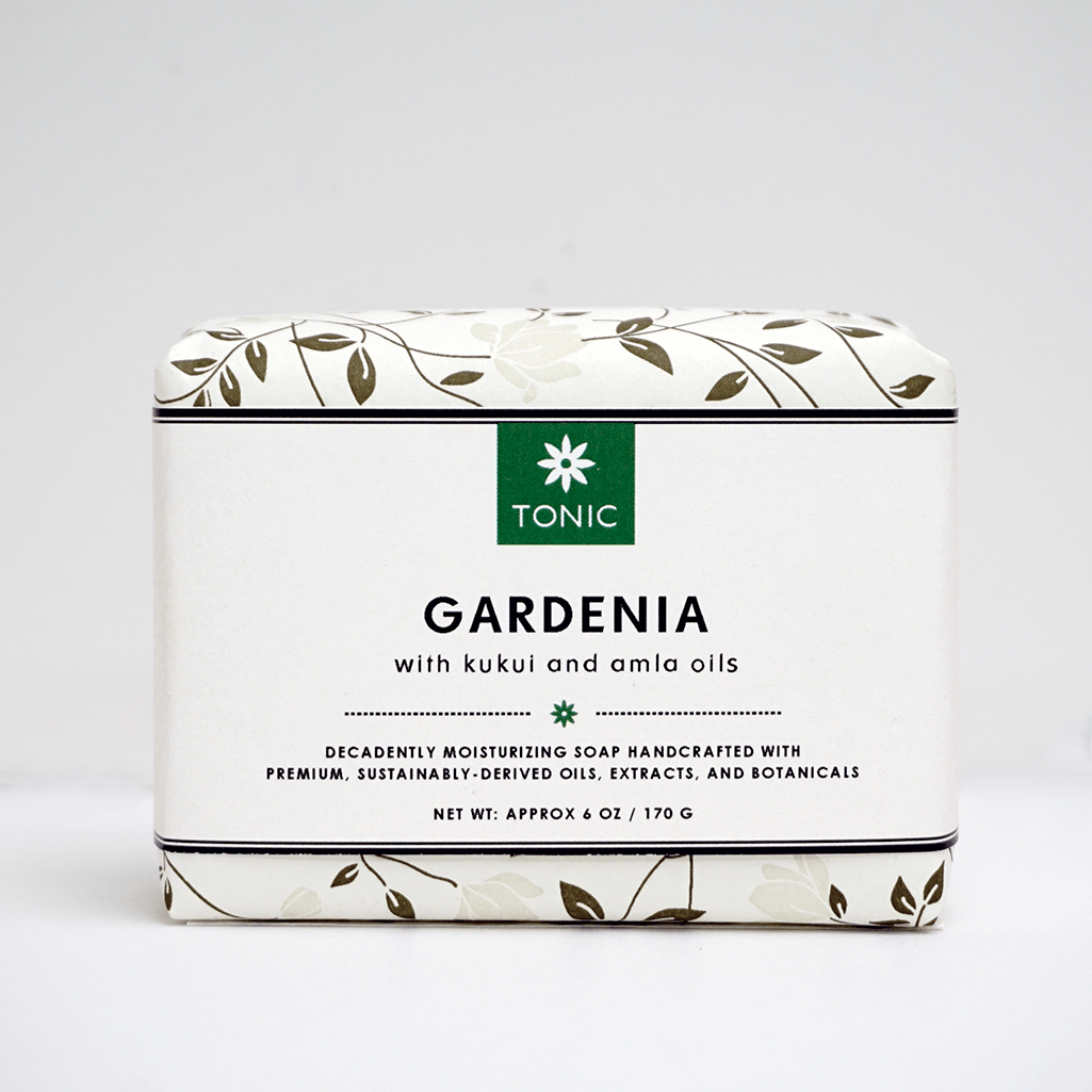 Tiare Gardenia Absolute Bar Soap with Kukui and Amla Oils, by TONIC. Wrapped, on an off white background