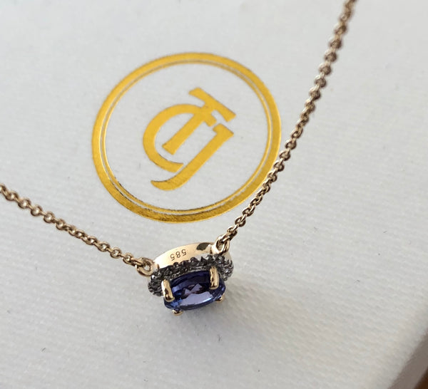 0.90ct Tanzanite and 0.06tcw Embrace Diamond Pendant in 14ct Yellow Gold CTJ