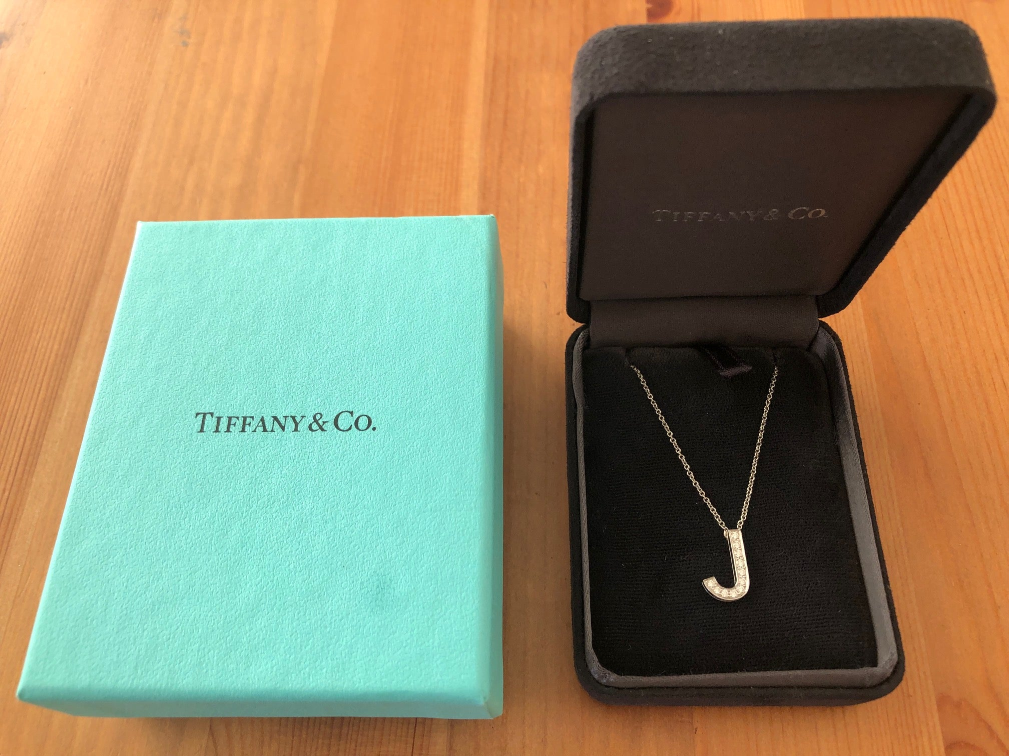 Tiffany & Co. 0.11tcw Diamond and Platinum 'J' Alphabet Necklace Receipt and Box