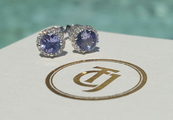 0.80tcw Tanzanite and 0.10tcw Diamond Halo 'Embrace' Earrings in 18ct White Gold by CTJ