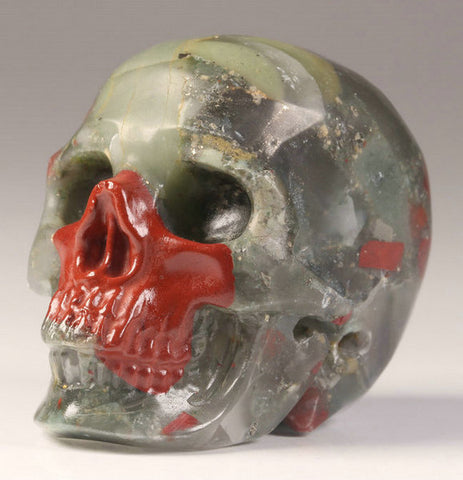 African Bloodstone natural crystal skull - Cast a Stone