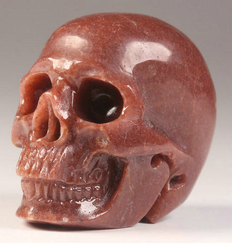 Red Aventurine natural crystal skull - Cast a Stone