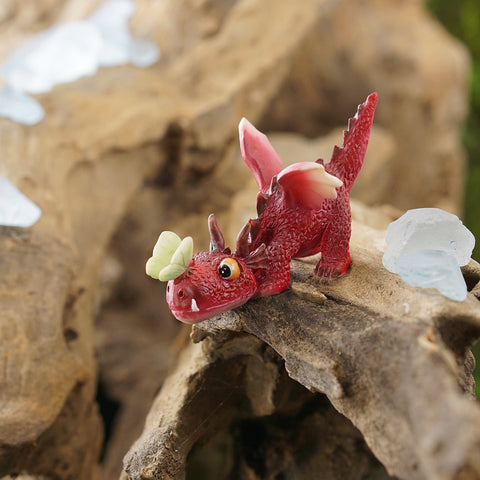 Mini Red Dragon Playing with Butterfly - Cast a Stone