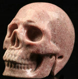 Pink Rhodonite natural crystal skull