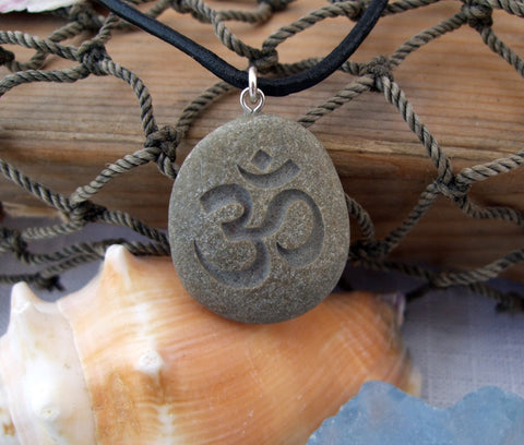 Om symbol - Natures first Breath necklace - Engraved Beach Stone Pendant - Cast a Stone