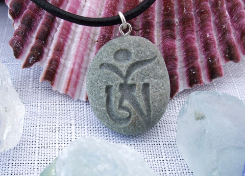 Tibetan Om symbol - engraved Beach Stone Pendant - Seed of Creation necklace - Cast a Stone