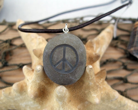 A sign of Peace - engraved Beach Stone Pendant - upcycled necklace - Cast a Stone
