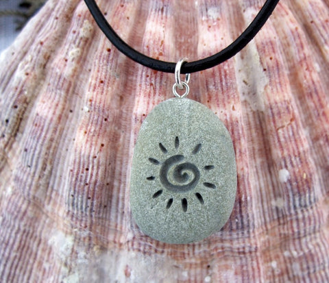 The Primitive Sun - deeply Engraved upcycled Beach Stone Pendant Jewelry - Cast a Stone