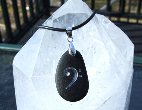 Musician's Bass Clef engraved in Silver on Black Sea Glass Pendant - Cast a Stone