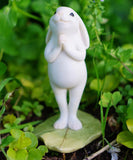 Yoga bunny standing Namaste pose - Cast a Stone