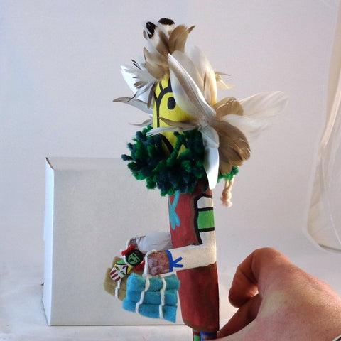 Qoqole (Yellow) giving gifts kachina