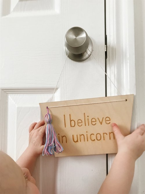 I believe in unicorns sign for nursery by Parade and Company