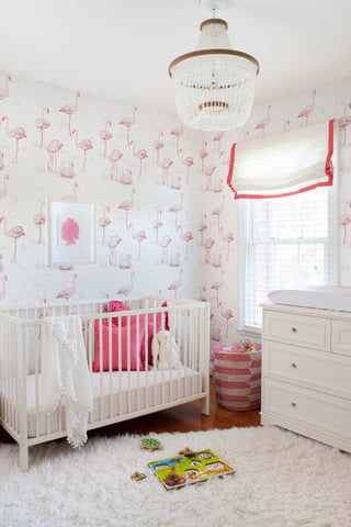 Pink flamingo wallpaper in baby girl nursery