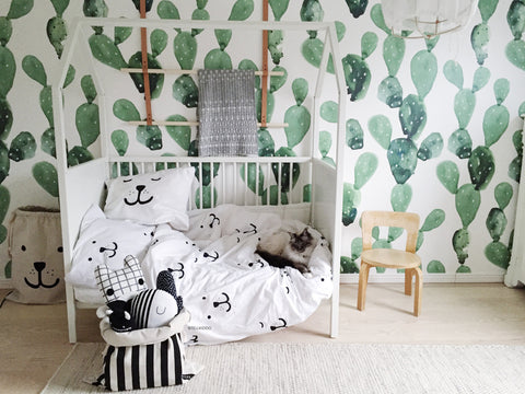 Quirky and fun cactus wallpaper in baby nursery