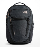 The North Face Women's Surge Backpack in TNF Black Heather/Burnt Coral Metallic